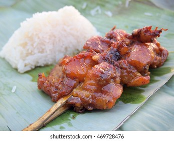 Skewer chicken pieces and sticky rice