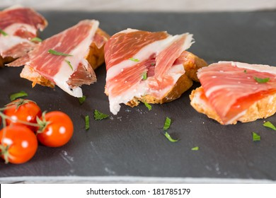 Skewer iberico ham with his bread with tomato
