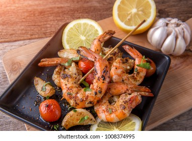 Skewers Barbeque grilled prawns with spicy ingredients garlic and tomato ready to serve.