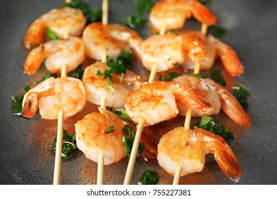 Skewers with delicious grilled shrimps, closeup