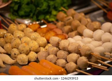 Skewers Display Thai Street Food Background Pork and Chicken meatballs, Thailand