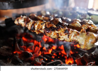 Skewers with meat on the barbecue grill