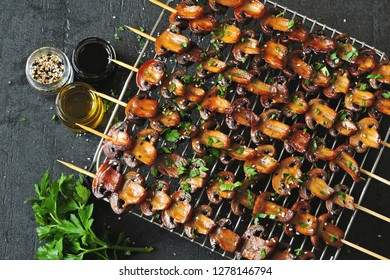 Skewers with mushrooms. balsamic grilled mushroom. Vegan mushroom skewers with parsley and garlic.