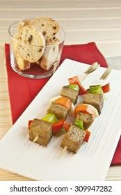 Skewers of seitan and vegetables, green and red peppers, orion, carrot, vegetarian food, vegan food, Vegetarian snack, food snaking