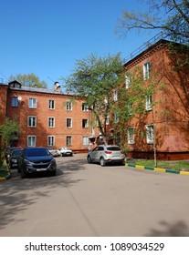 Skhodnya, Russia - May 07. 2018. residential buildings of red brick in old buildings
