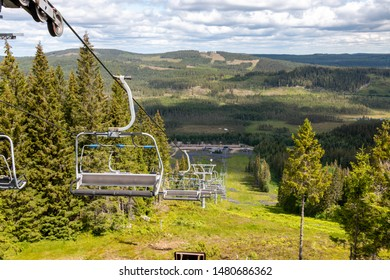 Ski area at the Safsen resort region Dalarna in Sweden, view on the chairlift and the valley