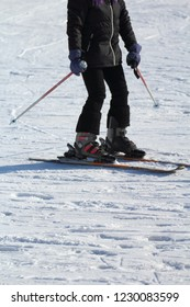 a ski athlete arrives at the end of the descent