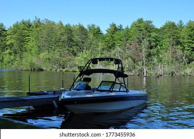 Ski boat on the pond at dock
