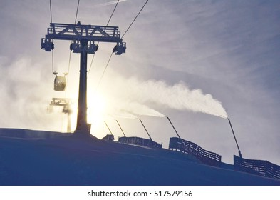 Ski cable car in winter landscape before ski season. - Hill is covered by artificial snow