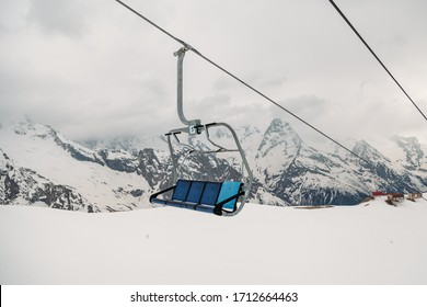 ski chair lift ropeway at the ski resort, view from the funicular to the mountains