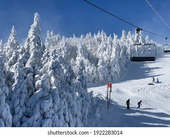 Ski chair lifts at Okemo mountain ski resort at sunny winter day in Vermont USA