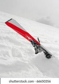 Ski crashed into deep snow