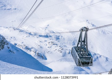 Ski gondola in Italian Alps arriving at Plateau Rosa in the Aosta Valley region of northwest Italy.