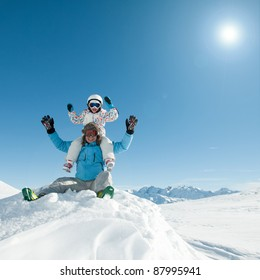 Ski holiday - Skiers playing in snow (copy space)