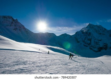 Ski holiday, sunny day in popular Alpine ski resort, Solda (Sulden), South Tyrol, Italy