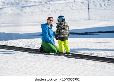 Ski Instructor Teaching a 3-Year Old Toddler Boy at a Mountain Resort