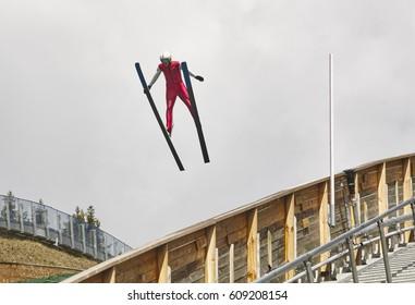 Ski jump. Artificial track. Sport background. Norwegian summer. Horizontal