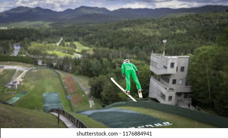 Ski jump athlete jumping at a summer practice in Lake Placid, NY
