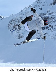 a ski jumper about to have a painful crash landing