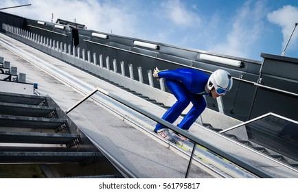 Ski jumper in squatting position