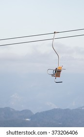 Ski lift above the clouds