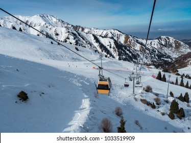 Ski lift in Almaty mountains. Shymbulak Ski Resort Hotel in Almaty city, Kazakhstan, Central Asia.