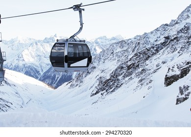Ski Lift Chairs On Bright Winter Day In Alp Mountains