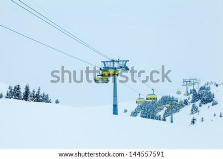 Ski Lift With Chairs. Lift To The Top Of The Mountain At Ski Resort