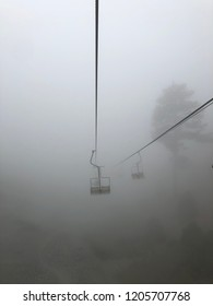 Ski lift in dense fog