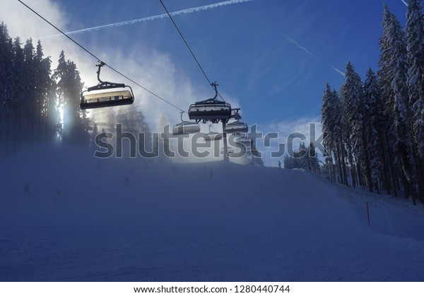 Ski lift encased in fog