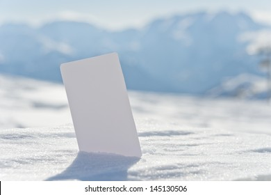 Ski lift pass stuck in snow ready for your design. Concept to illustrate winter sport admission fee