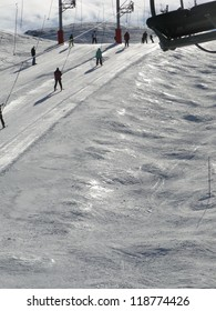 Ski lift and skiers  in alpine snow Portes du Soleil, Avoriaz, France