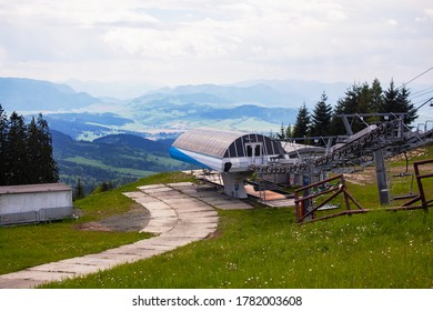Ski lift in the Slovak Tatras in summer, with mountains in the background.