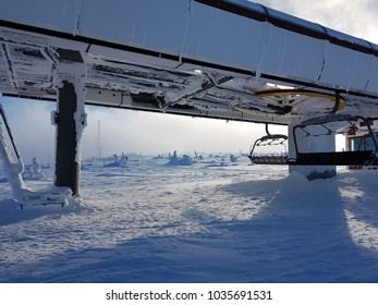 Ski lift station on top of a mountain in a frozen landscape