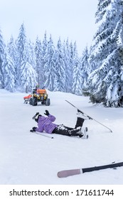 Ski patrol rescue injured woman after accident lying in snow
