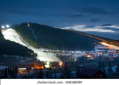 Ski piste and village of Bukovel ski resort in Carpathians, western Ukraine