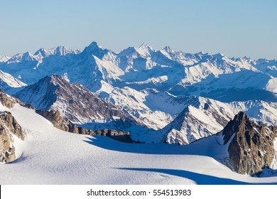 Ski resort  Chamonix Mont Blanc. The mountain is the highest in the Alps and the European Union. Alpine mountains range landscape in beauty French, Italian and Swiss ALPS seen from Aiguille du Midi