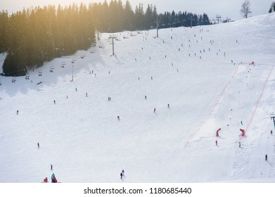 Ski resort. Downhill view. Downhill skiing people.