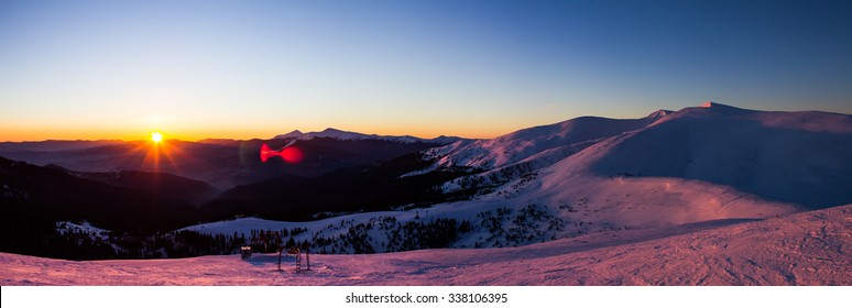 ski resort panorama in the morning when the sun rises and illuminates the snow-capped peaks