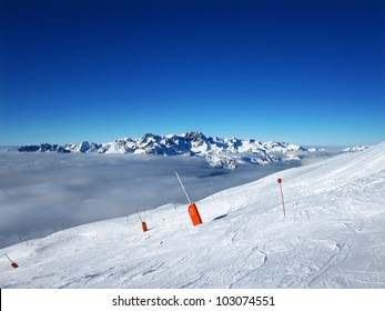 Ski Resort Skiing Down Mountain Slope Peak in the French Alps View from top Above Clouds
