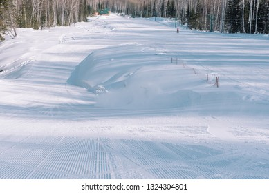 Ski resort. Snow slope. Active lifestyle. Ride from a snowy mountain. Snow mountains in Russia