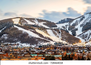 Ski runs and city lights above Park City, Utah, USA.