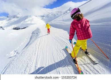 Ski, skiers on ski run - child skiing downhill