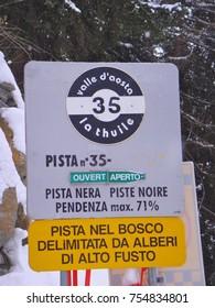 Ski slope 35 Val d'Aosta Italy bordered by tall trees... ski slope slope 71 %
