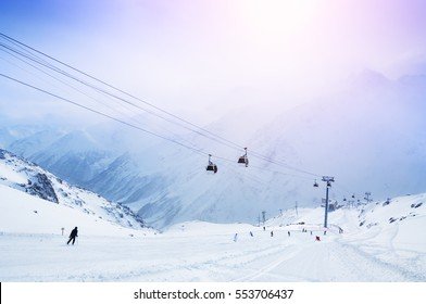 Ski slope and cable car on the ski resort. Elbrus, Caucasus, Russian Federation.