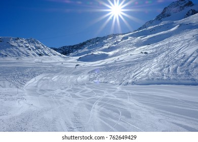 Ski slope in Chamonix le brevet with perfect conditions and blue sky