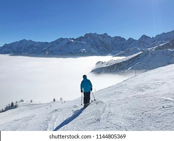 Ski slope in Garmisch Partenkirchen over misty valley