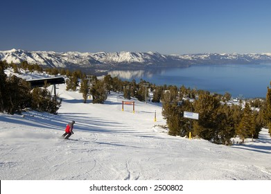 Ski slope motion blurred skier at lake Tahoe resort with the lake in the background.