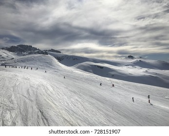 Ski slope with people groups and alone in Alps Joue du Loupe