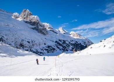 Ski slope under Marmolada Glacier, Ski Resort of Dolomites Mountain in Italy.
